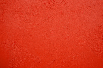 Empty red concrete wall, clean texture background surface.