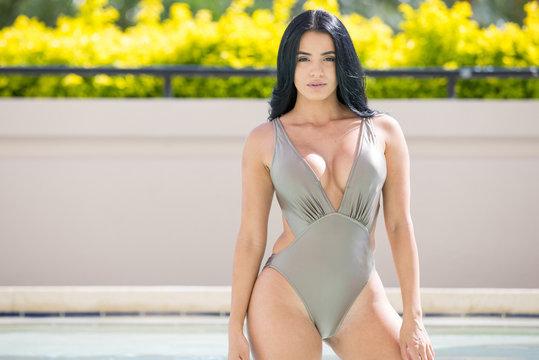 Beautiful hispanic woman in swimming pool