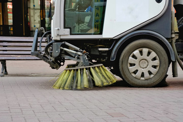 Sweepers car machine or sweeper machine cleaning on the streets.