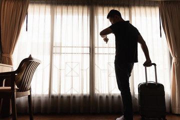 man holding luggage in the hotel