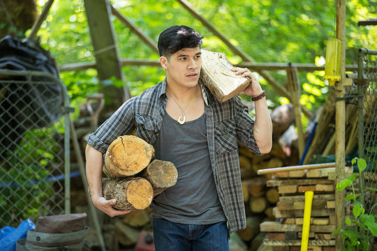 Strong man carrying firewood