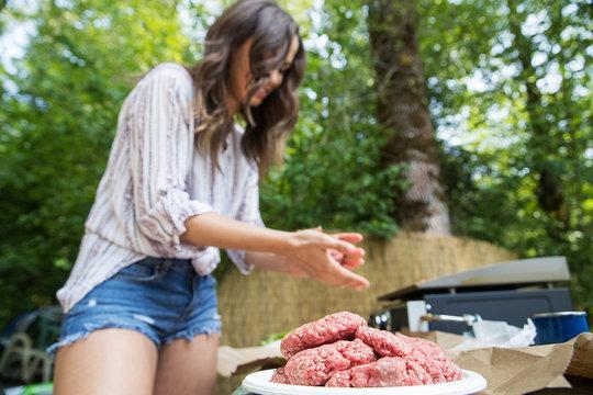 Woman making hamburger patties