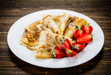 Crepes with cream and strawberries