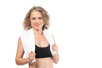 cheerful confident young woman with towel after gym