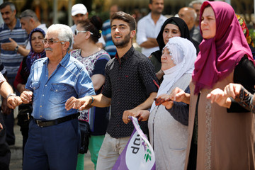 Birhat Demir, a candidate for the pro-Kurdish HDP in the June 24 parliamentary election, dances during an election campaign in Denizli
