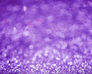 Lilac or violet bokeh background of glitter lights