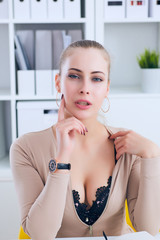 Sexy secretary undresses in office, flirt and desire. Office provocation.