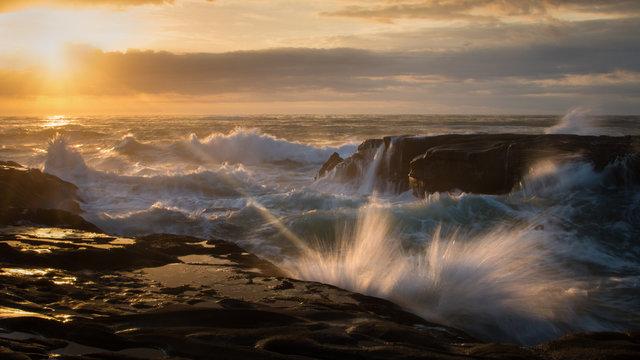 Splashing waves in Muriwai Beach, West Auckland New Zealand