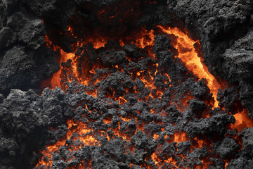 Close-up of a lava flow of volcano Kilauea on Hawaii