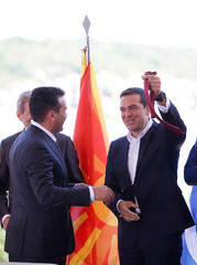 Greek Foreign Minister Kotzias and his Macedonian counterpart Dimitrov sign an accord to settle a long dispute over the former Yugoslav republic's name in the village of Psarades
