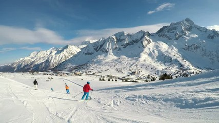 Wall Mural - Man skiing on the prepared slope with fresh new powder snow in Rhaetian Alps , Adamello, Tonale, Italy