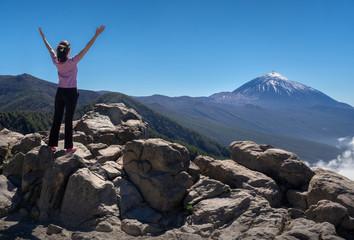 tourist girl enjoys the view of the volcano Teide