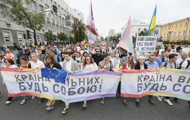 Participants carry a banner during the Equality March in Kiev