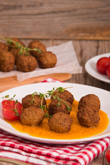 Meatballs with carrot purée.