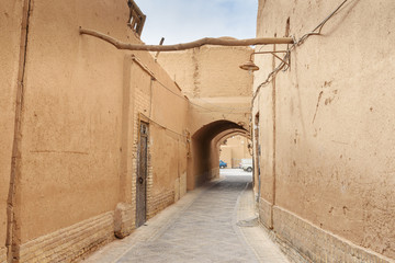 Narrow street with arches of old town in Yazd. Iran