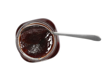 cherry jam in glass jar and metal spoon isolated on white background, top view, clipping path