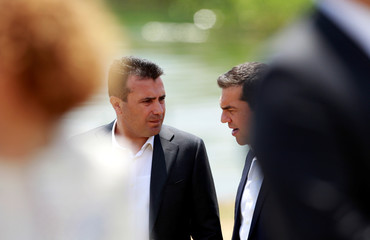 Macedonian PM Zaev and Greek PM Tsipras after the signing of an accord to settle a long dispute over the name of Republic of Macedonia, in the village of Otesevo