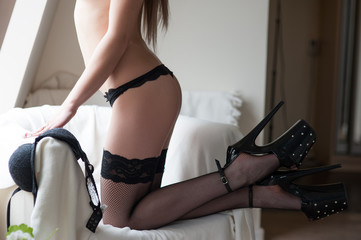 Sexy girl in black stockings and striptease shoes