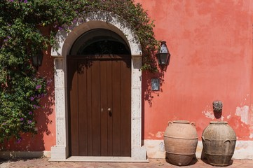 Beautiful door decorated with flowers in italian farm house