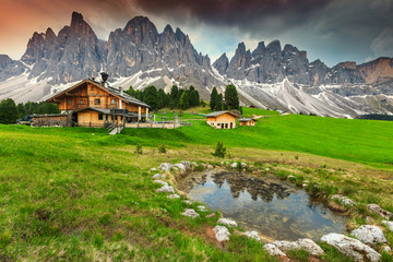 Wall Mural - Spectacular alpine chalets with mountain lake in Dolomites, Italy, Europe