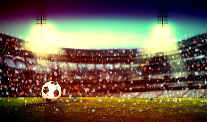 Soccer stadium with soccer ball on the green grass