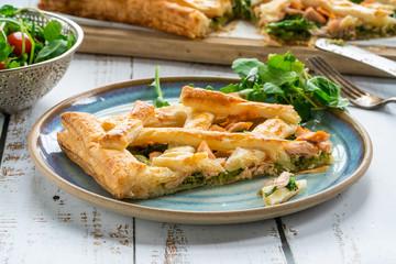 Salmon and broccoli tart with fresh leaf salad