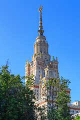 Tower of Lomonosov Moscow State University (MSU) against blue sky in sunny summer evening