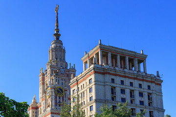 Towers of Lomonosov Moscow State University (MSU) on a blue sky background in sunny summer evening
