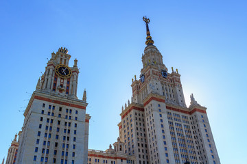 Towers of Lomonosov Moscow State University (MSU) on a blue sky background at summer evening