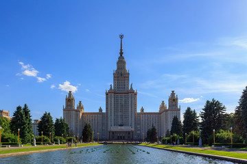 View of main building of Lomonosov Moscow State University (MSU) on a background of fountain at summer evening