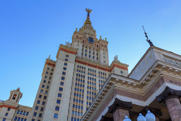Tower of main building of Lomonosov Moscow State University (MSU) against blue sky in sunny summer evening