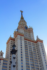 Lomonosov Moscow State University (MSU) tower on a blue sky background in sunny summer evening