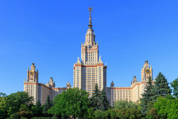 Buildings of Lomonosov Moscow State University (MSU) against blue sky in sunny summer evening