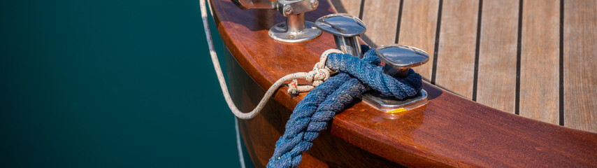 dock cleat on the side of a boat in a small marina, an element of yachting equipment Fototapete