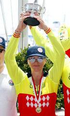 Princess Charlene of Monaco holds up her trophy after winning with her team the Riviera Water Bike Challenge in support of the Princess Charlene foundation in Monaco