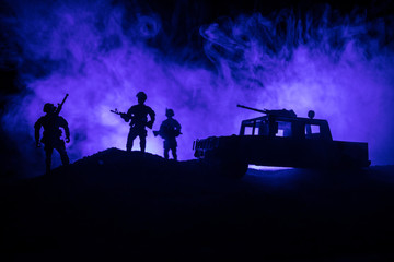 War Concept. Military silhouettes fighting scene on war fog sky background, World War Soldiers Silhouettes Below Cloudy Skyline At night. Attack scene. Army jeep vehicles with soldiers. army jeep