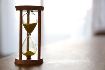 Hourglass as time passing concept for business deadline.