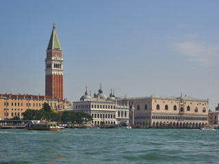 Campanile and Doges Palace in San Marco, Venice, Italy viewed over the lagoon from St Marks Basin in a scenic cityscape