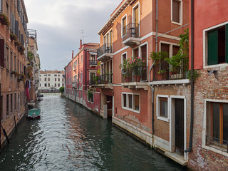 Tranquil back canal with colorful historic houses with balconies and greenery, Venice, Veneto, Italy , a popular tourist destination