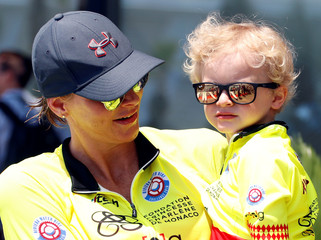 Princess Charlene of Monaco and her son Prince Jacques attend the Riviera Water Bike Challenge in support of the Princess Charlene foundation in Monaco