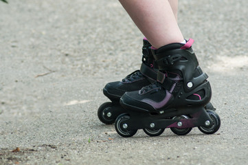 closeup of feet of woman with roller blade on the road