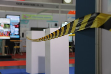 Barrier tape for no entry at an exhibition.do not cross ribbons.