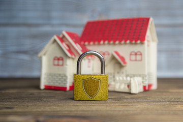 Closed lock on the background of the house, the concept of security and alarm