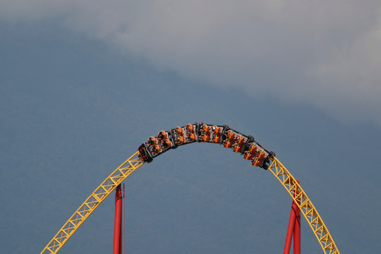 People ride a roller coaster in the Black Sea resort of Sochi