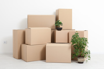 Moving into a new apartment. Move lots of cardboard boxes in an empty new apartment.