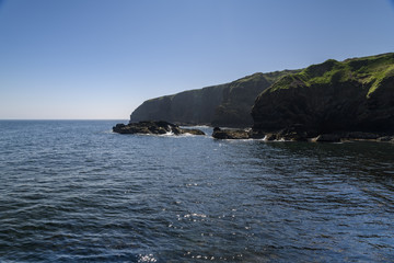 The southern cliffs at the entrance to Lybster Harbour in Caithness, Scotland.