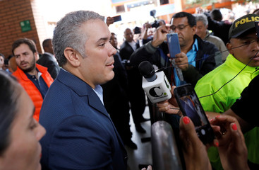 Presidential candidate Ivan Duque talks to the media after casting his vote at a polling station, during the presidential election in Bogota