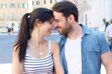 Young happy couple in love outdoors.Loving man and woman in the city