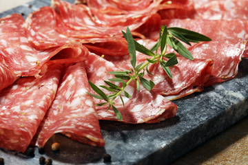 thinly sliced salami . delicious snack rustic salami
