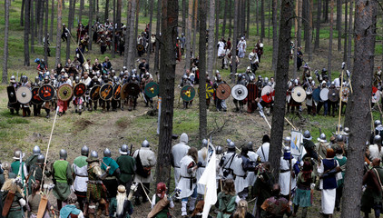 "Participants dressed as characters from J.R.R. Tolkien's novel ""The Hobbit"" re-enact the ""Battle of Five Armies"" in a forest near Doksy"